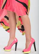 stylish pink high heels with a green yellow trim - stock photo