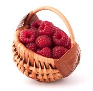 Ripe raspberries in basket Stock Photos