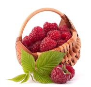 ripe raspberries in basket - stock photo