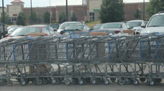 1080P stock - Shooping carts being pushed in lot Stock Footage