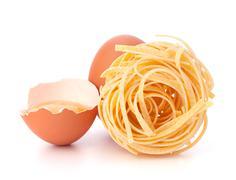 italian pasta tagliatelle nest - stock photo