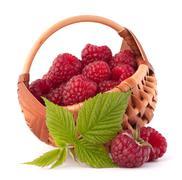Ripe raspberries in basket Stock Photos