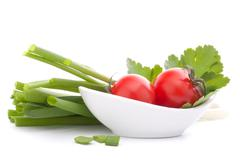 Spring onions and cherry tomato in bowl Stock Photos