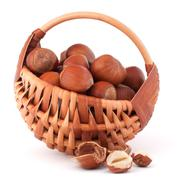 hazelnuts in wicker basket - stock photo