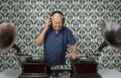Funky grandpa dj with gramophones Stock Photos