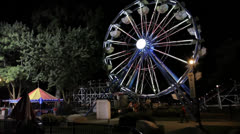 Large Ferris Wheel at Night, Wide Shot, Side View Stock Footage