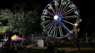 Stock Video Footage of Large Ferris Wheel at Night, Wide Shot, Side View
