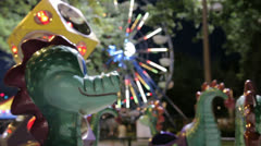 Children's Ride, Dragons Close up, Ferris Wheel in Background Stock Footage