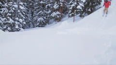 Skier Crashes into Powder - stock footage