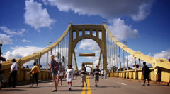 Pirates Fans Walk Across the Roberto Clemente Bridge Stock Footage