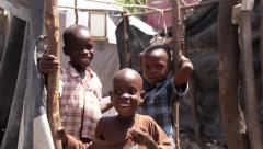 Haiti - Young Haitian Boys in a Tent City (children kids) - stock footage
