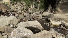 Water flowing through a rocky valley Stock Footage