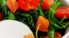 Salad with salmon in white bowl Stock Footage