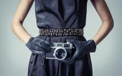 beautiful fashion girl with an analogic photo camera - stock photo