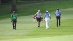 Pro golfer Jason Day walks to the putting green. Stock Footage