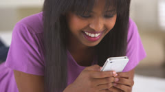Stock Video Footage of African American girl texting on mobile phone