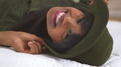 Black girl wearing floppy hat on bed Stock Footage