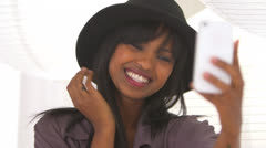 Black girl taking pictures of herself with floppy hat on Stock Footage