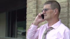 Relaxed businessman on cell phone Stock Footage