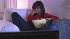 Black girl watching sad movie at home Stock Footage