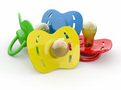 Baby's pacifiers on white isolated background. 3d Stock Illustration