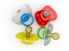baby's pacifiers on white isolated background. 3d - stock illustration