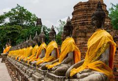 Thai buddha statue in wat yai chai mong kol , ayutthaya thailand Stock Photos