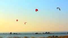 Kitesurfers in the evening Stock Footage