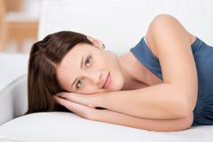 Beautiful young woman relaxing Stock Photos