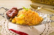 Stock Photo of biryani chicken rice with traditional india food