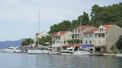 Yachts and restaurants on island Mljet Stock Footage