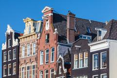 ancient canal houses in the dutch capital city amsterdam - stock photo