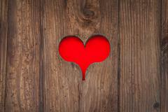 Cut out old wooden red heart shape Stock Photos