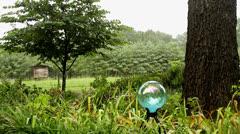 Blue garden orb heavy rain Stock Footage