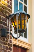 Antique dutch lantern covered with icicles Stock Photos