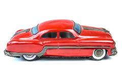 Fifties vintage red car toy isolated on white Stock Photos