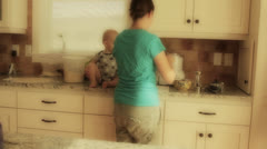 A baby boy and his mother in the kitchen Stock Footage