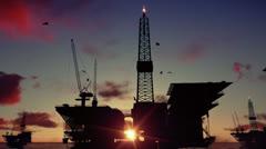 Oil rigs in ocean at sunrise, timelapse - stock footage