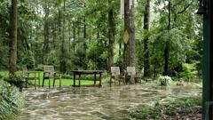 stone path chairs heavy rain - stock footage