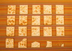 bitten crackers background - stock photo