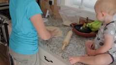 A mother and baby making a pizza Stock Footage