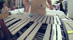 Fisheye street musician perform Xylophon or Cylophone Music instrument Stock Footage