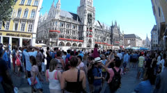 Fisheye international tourists group watching Glockenspiel at Munich Town Hall - stock footage