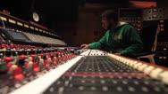 Stock Video Footage of Black Engineer Mixing in Recording Studio - Ew 02