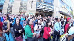 Fisheye Asian tourists group watching Glockenspiel at Munich Town Hall - stock footage
