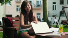 Female student finishing work on laptop and relax in park HD - stock footage