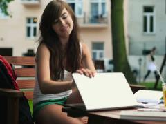 Female student finishing work on laptop and relax in park NTSC - stock footage