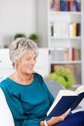 Reading senior woman Stock Photos