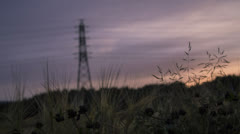 Motion time lapse parallax effect, evening light, sunset, power pole cornfield Stock Footage