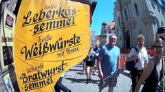 Fisheye Munich Viktualienmarkt market Leberkasse white sausage advertisement Stock Footage